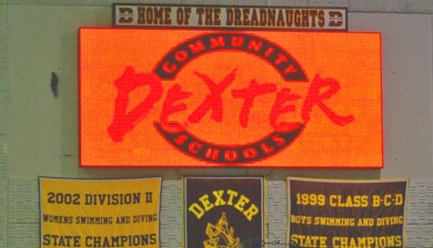 dexter community schools swimming scoreboard with text and animations