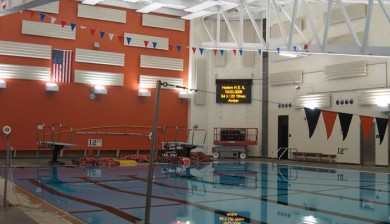 harlem high school swimming scoreboard with text and animations